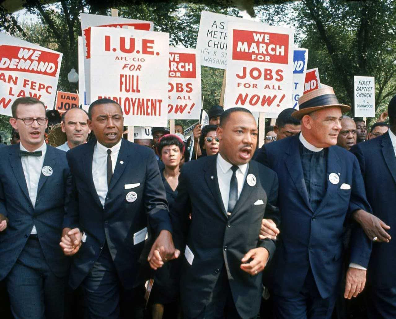 Martin Luther King, Jr. and others marching for jobs and justice.