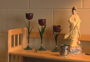 Mary's special book case with spiritual figurines