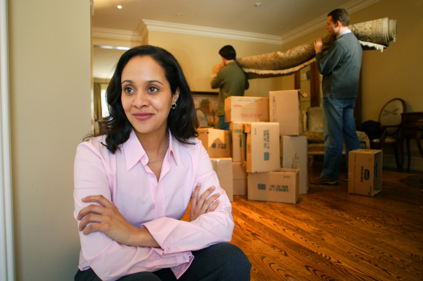 woman with boxes packed, ready to move
