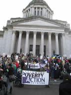 Poverty Action members rally on the steps of the Capitol
