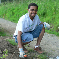 Sudi, a Seattle Community Farm volunteer and Rainier Vista resident