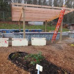 The surface lumber is positioned and attached, completing the canopy base structure.