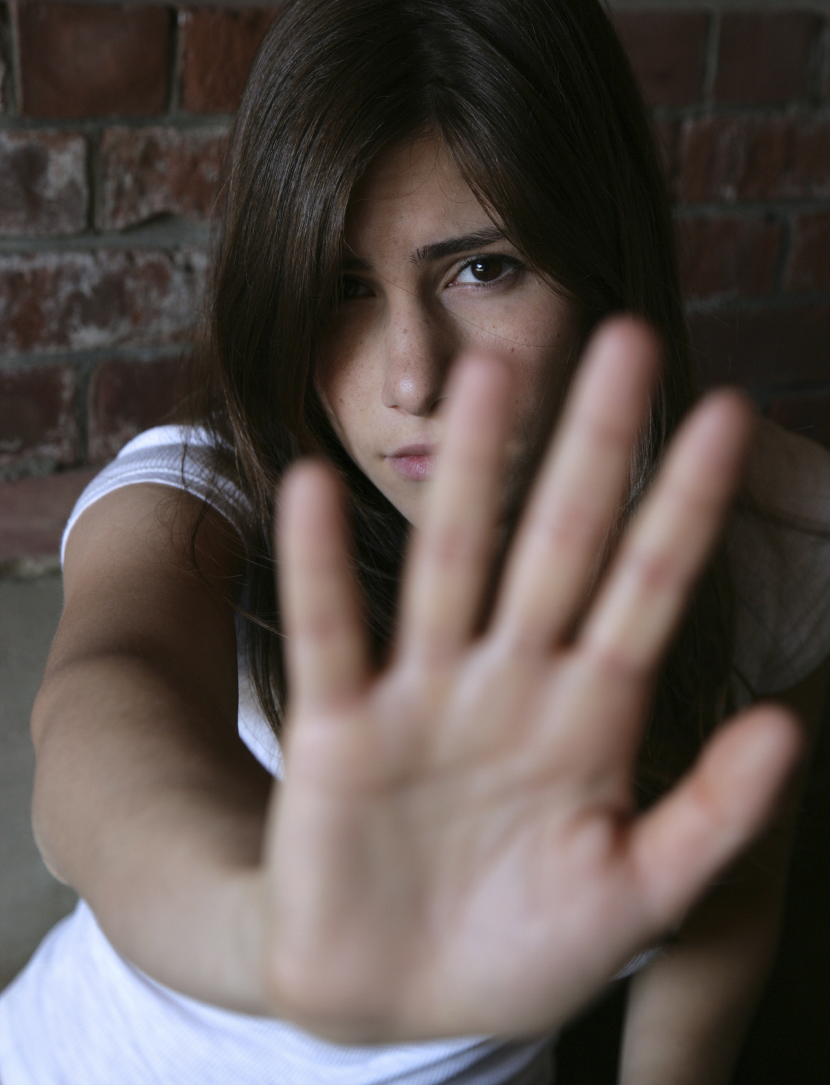 girl guarding herself with hand up