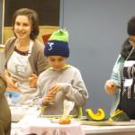 Participants seasoning the squash for roasting.