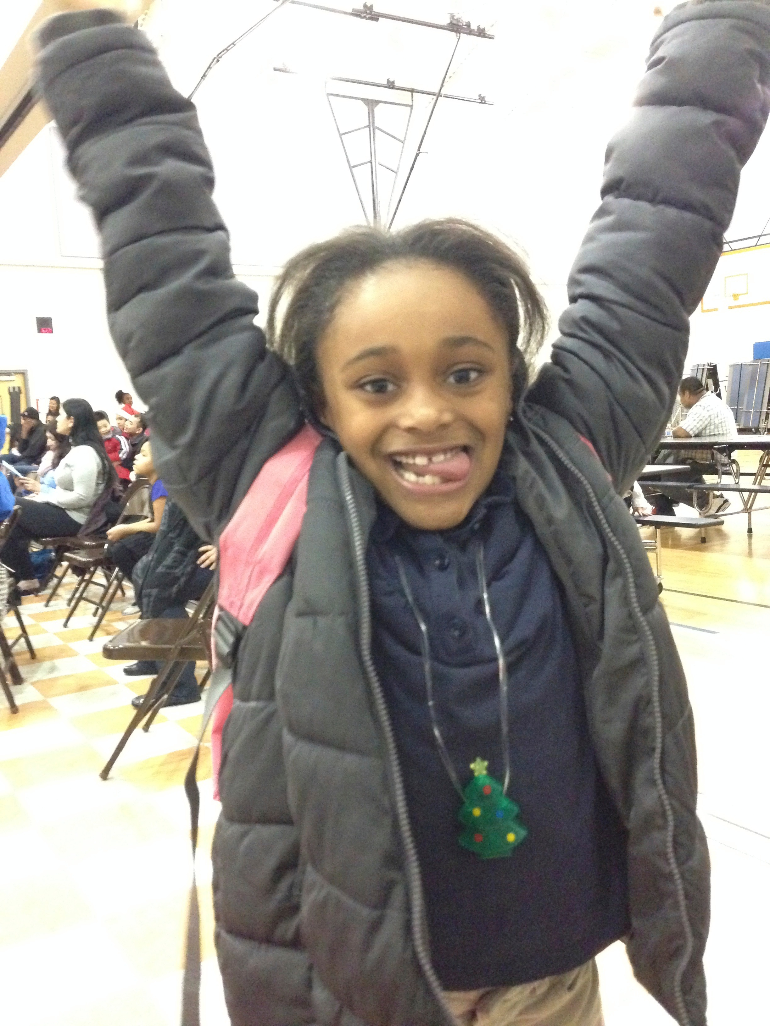 Alivia, an energetic 2nd grader at Emerson, takes the jumping jack challenge!
