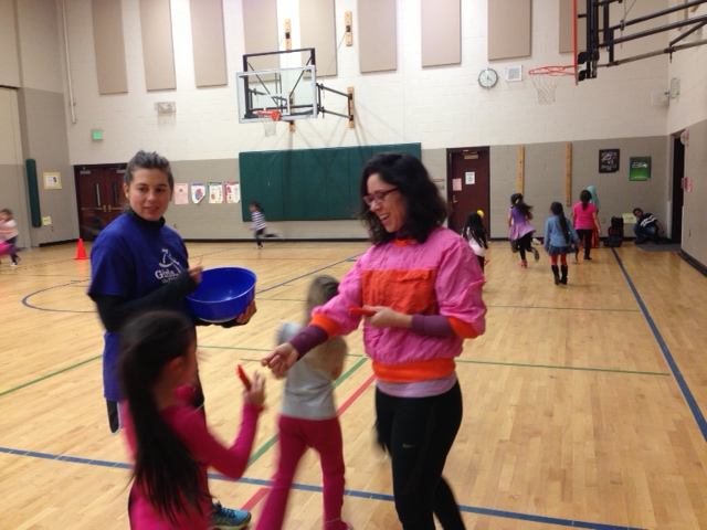 Ms. Kelly & Ms. Pam give lap-markers to speedy 1st graders!