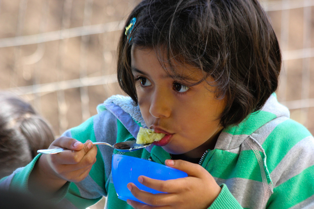 A Concord International School 3rd grader tastes food made from fresh ingredients at Lettuce Link's Giving Garden at Marra Farm.
