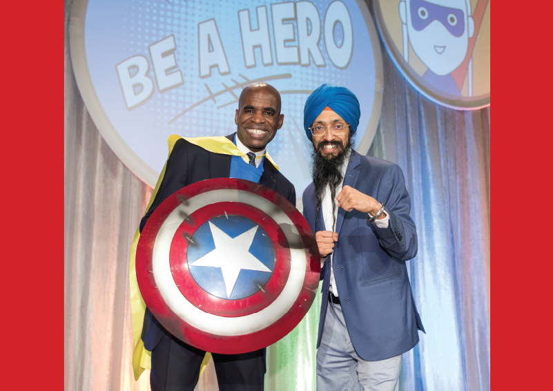Solid Ground Luncheon keynote speaker Vishavjit Singh & President & CEO Gordon McHenry, Jr. are true superheroes!