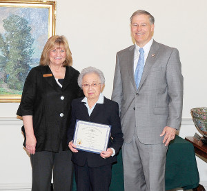 Sue Fujino with Governor Jay Inslee & First Lady Trudy Inslee (Photo courtesy of the Governor's Office)