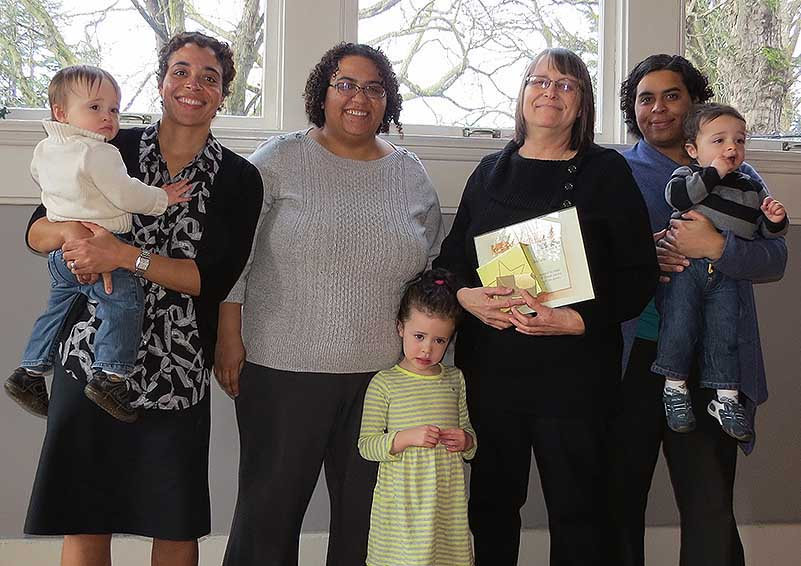 Anita Alokolaro with her daughters & three of her grandchildren, as she accepted a Solid Ground Service Award