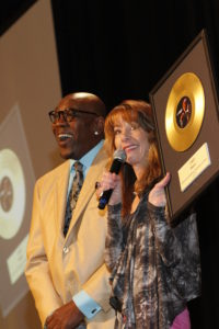 Emcee Nancy Guppy presents Wanz with a golden album award (photo by John Bolivar)