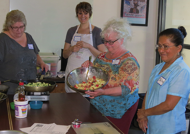 Cooking Matters students show reveal their colorful dishes.