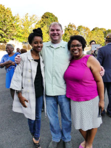 Shanelle with her husband, Mike West, and Reagen Price (l), Solid Ground's Anti-Racism Initiative Manager