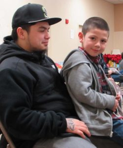 Anthony sits on his Uncle Jeremy's lap, MLK Lobby Day 2015 (photo by Liz Reed Hawk)