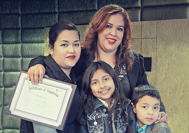Maricela (center) with three of her four children (l to r): Maira, Jocelyn and Jonathan (photo by Bellen Drake)