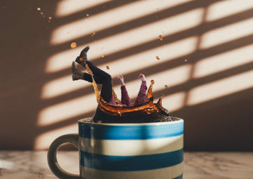woman falls into cup of coffee