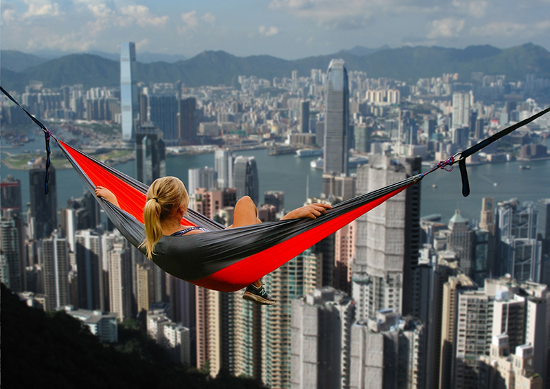 Woman in hammock over Hong Kong