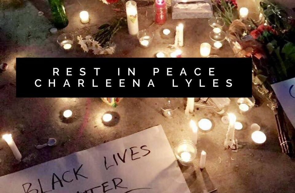 Flowers and candles creating a shrine to Charleena Lyles