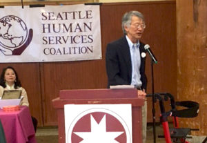 Tony Lee accepting, former Solid Ground Advocacy Director, accepting Lifetime Achievement Award from Seattle Human Services Coalition