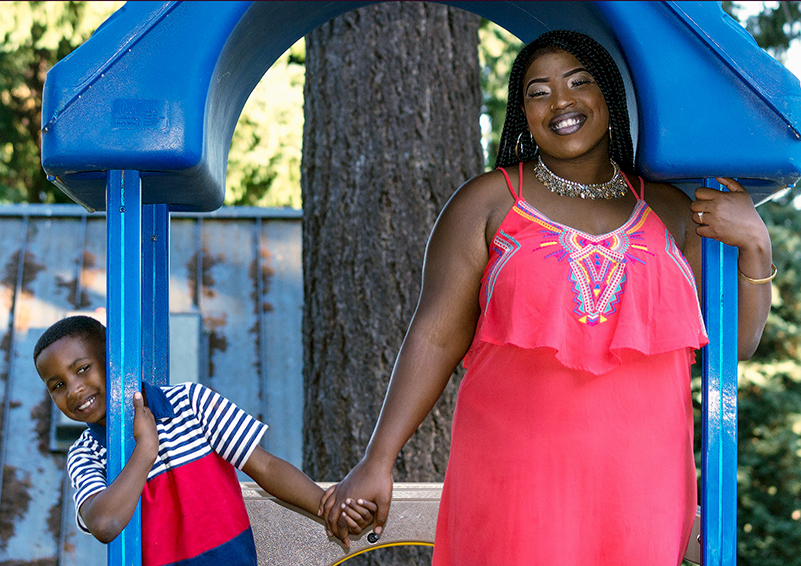 Ashley Potts with her son Marcus on a play structure at their favorite park (photo by Chris Villiers Photography)