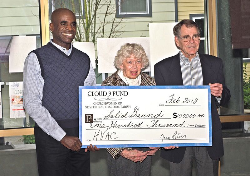 Cloud 9 Fund of St. Stephen's Episcopal Parish present a check for $100,000 to Solid Ground