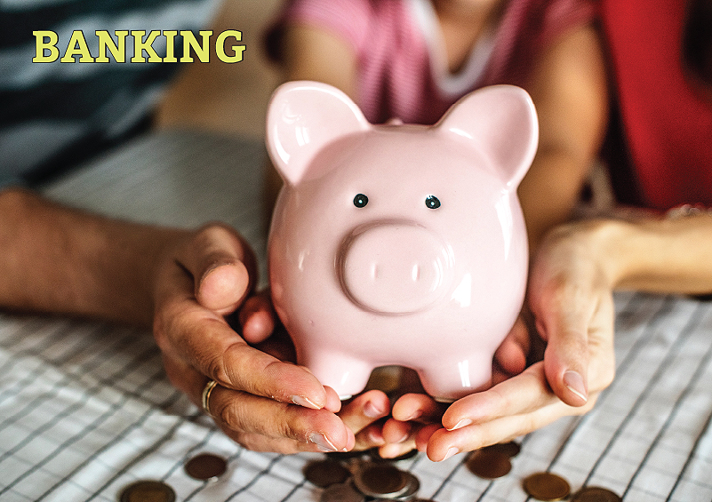 Banking: Hands of multiple generations hold a piggy bank