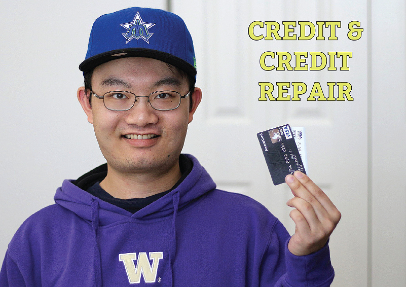 Credit & Credit Repair: Young man with glasses in a blue cap and UW sweatshirt holds up his credit card
