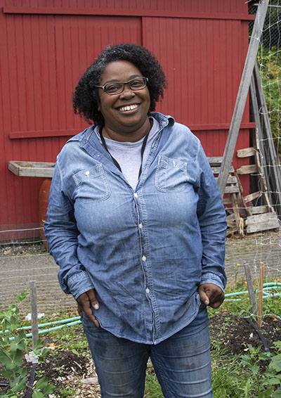 SCF Farm Manager Shanelle Donaldson helps the ACRS community reconnect with a rich food history & culture (photo by Lara Breitkreutz).