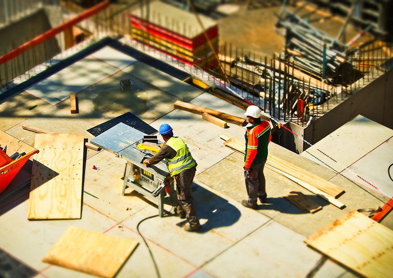 Aerial view of two construction workers on a job site