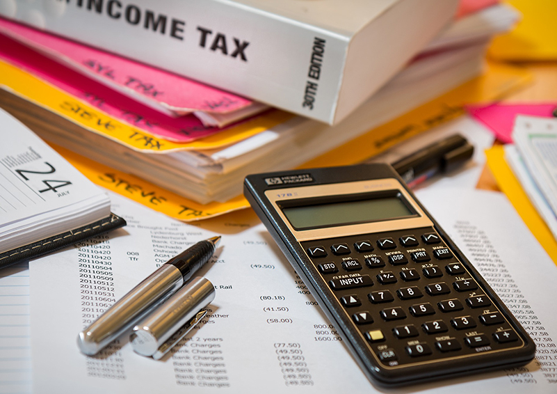 Income tax prep materials (book, pen, calculator, etc.)