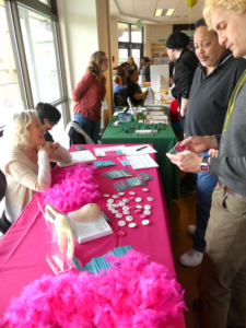 Health fair attendees stop at CanCan's table, a breast and ovarian cancer awareness organization.