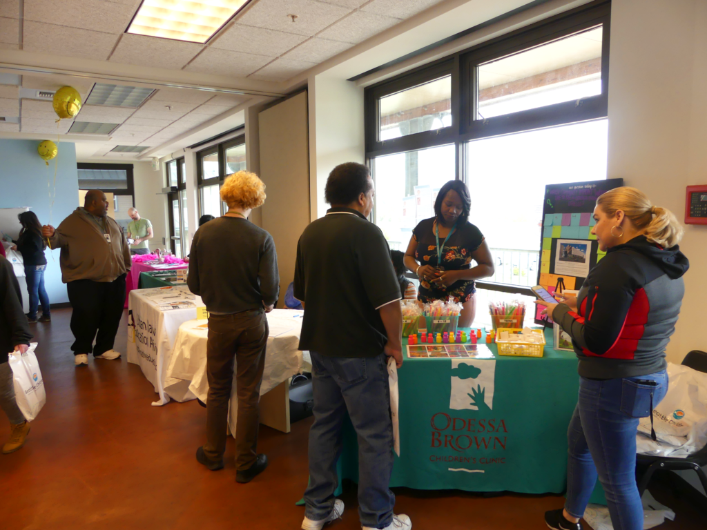 Health fair attendees visit the Odessa Brown Children's Clinic table.
