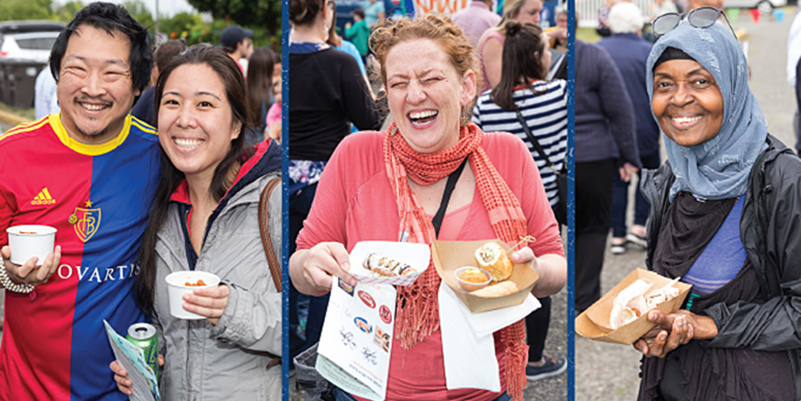 People smiling and holding food