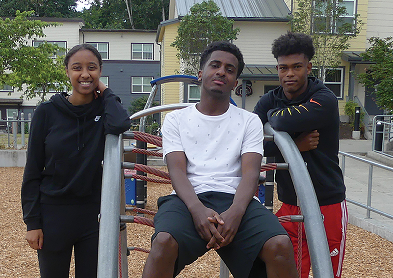 (L to r): Mekedes, Semere, and Bereket: Three Sand Point Housing Class of 2019 high school graduates who are all headed to college in the fall (photo by Liz Reed Hawk).