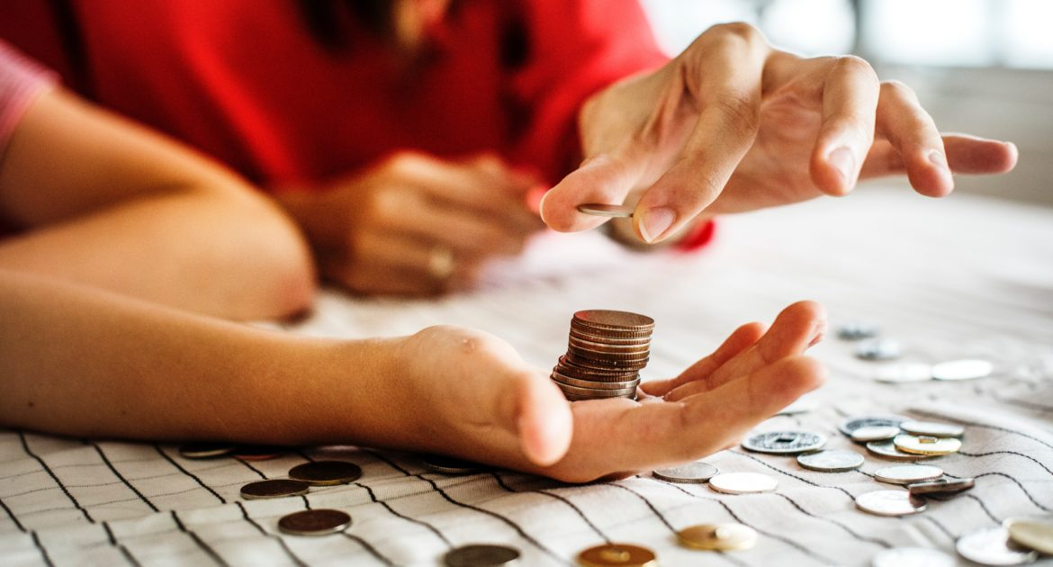 Adult hands counting coins
