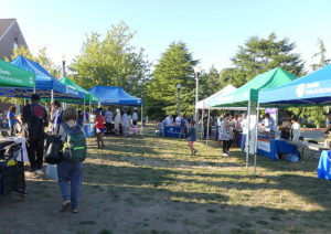Popup tents & tables at the Sand Point community back-to-school event