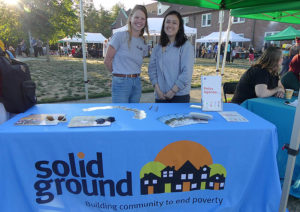Grants Team members Alex Weeks & Naomi Natsuhara table for Solid Ground.