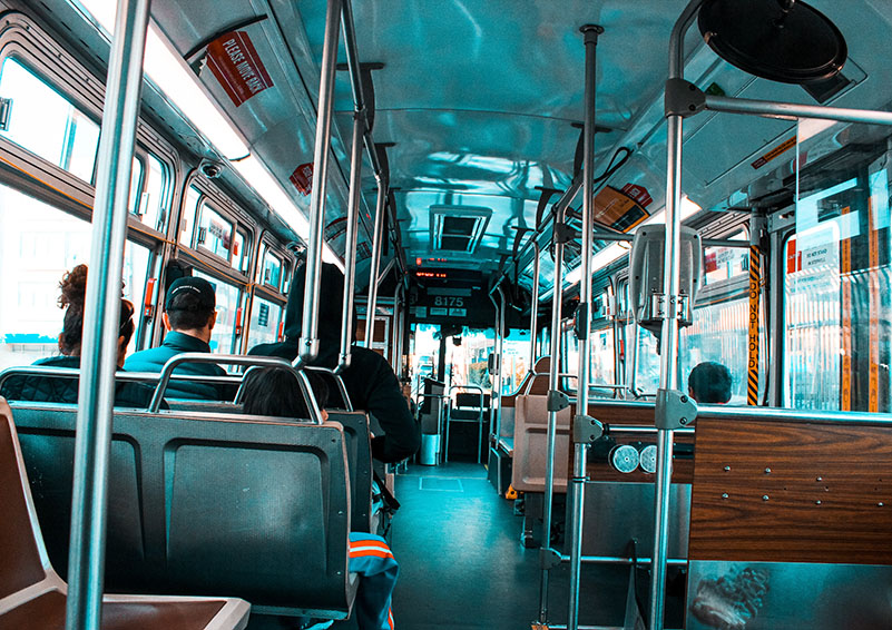 interior of a public bus with a blue tint