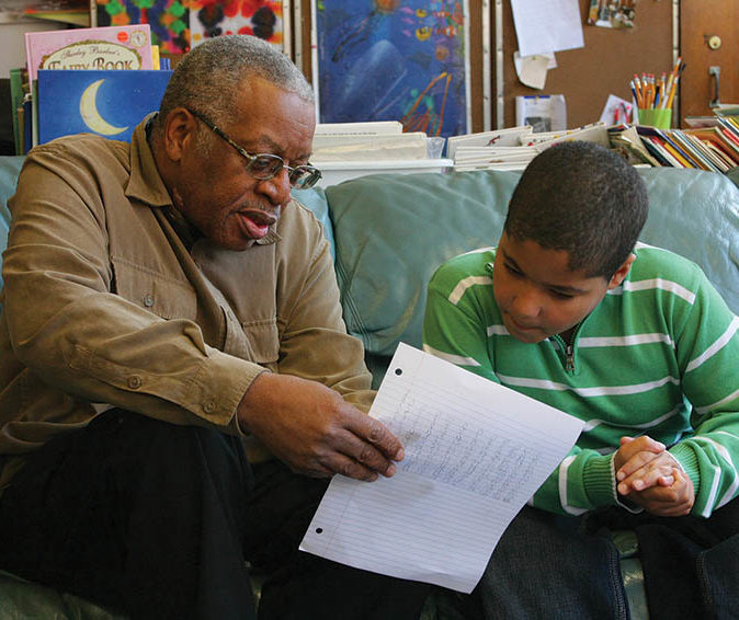 Older man tutors young boy