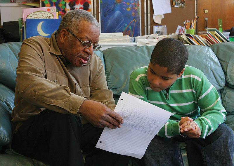 Older man tutors young boy