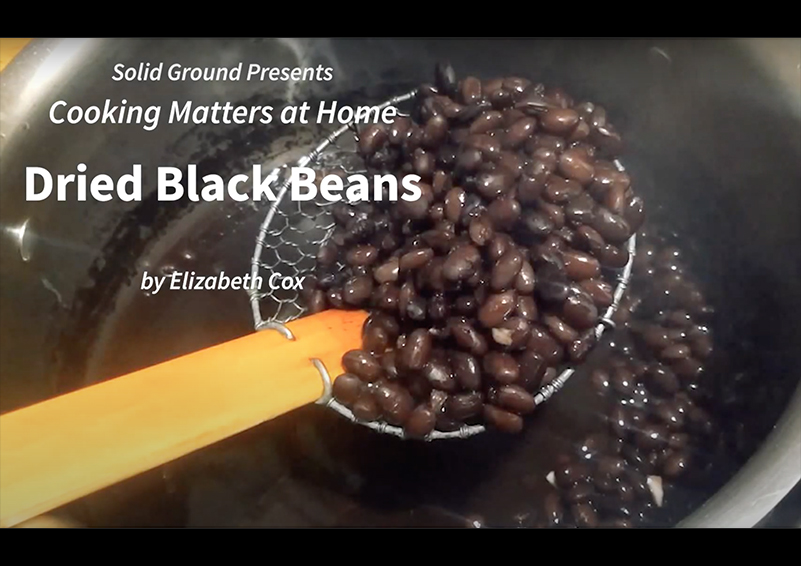 "Title card showing cooked black beans and states ""Solid Ground presents Cooking Matters at Home by Elizabeth Cox"""