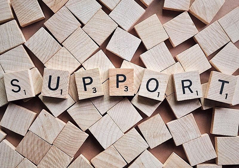 "Scrabble tiles spelling ""support"""