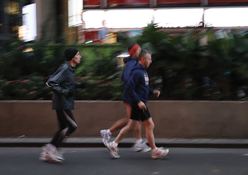 Stock image of three men jogging together