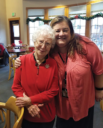 Zorna, Director of Administrative Services with Volunteer Maggie (105 years), a Northshore member since they opened their doors in 1976