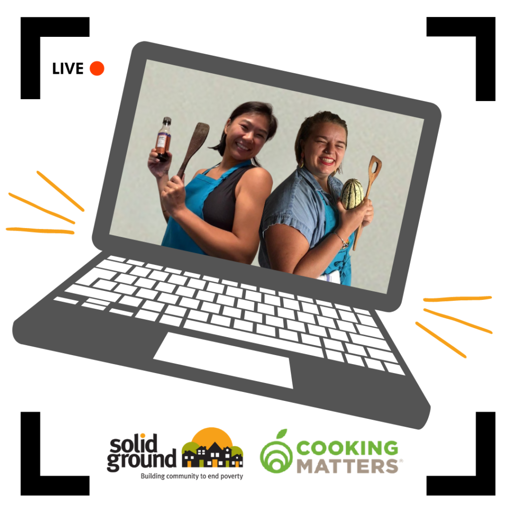 Picture of two women holding cooking tools wearing blue aprons on a computer screen