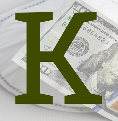 Forest green capital letter K over a $100 bill and face mask