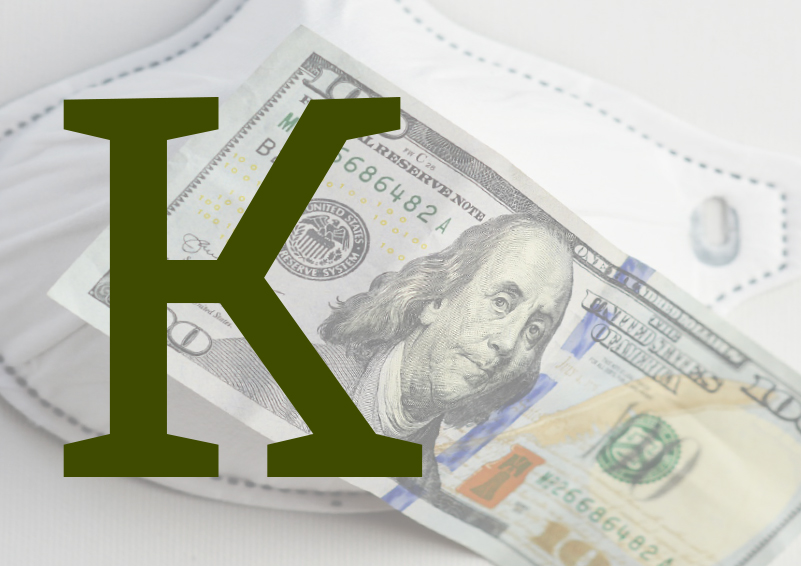 A large green letter K in front of a marked-up $100 bill over a white face mask