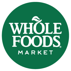 WHOLE FOODS MARKET circular dark green logo with white lettering