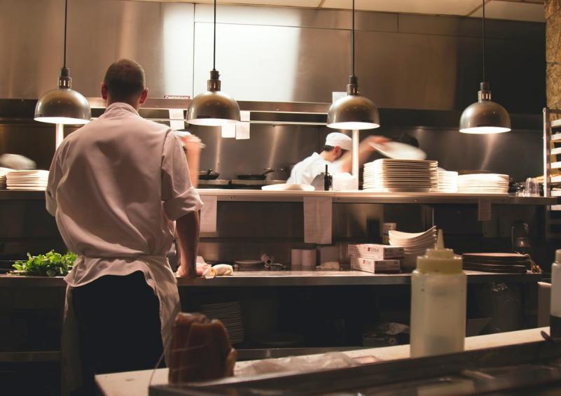 Two chefs in a restaurant kitchen