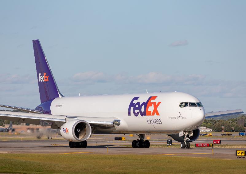 A FedEx airplane on a runway